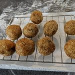 Sesame balls on a wire rack
