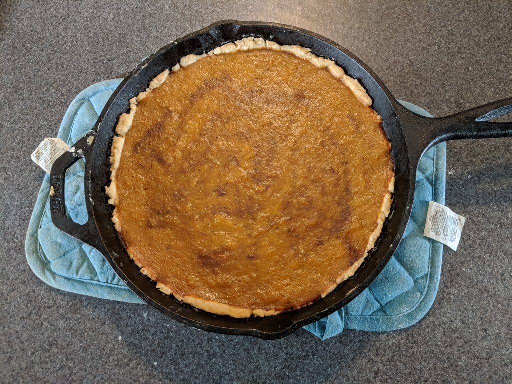 Finished pumpkin pie in a cast iron skillet.