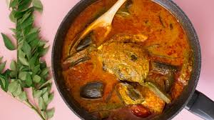 A soupy red curry with whole fish heads