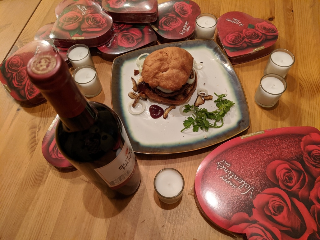 Finished vegan burger recipe. Complete with many Valentine's Day chocolates and a bottle of red wine.