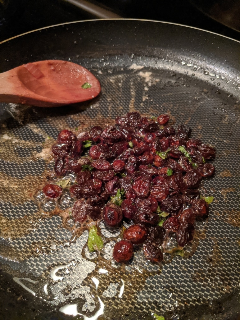Making the raisin, butter, and mint garnish.