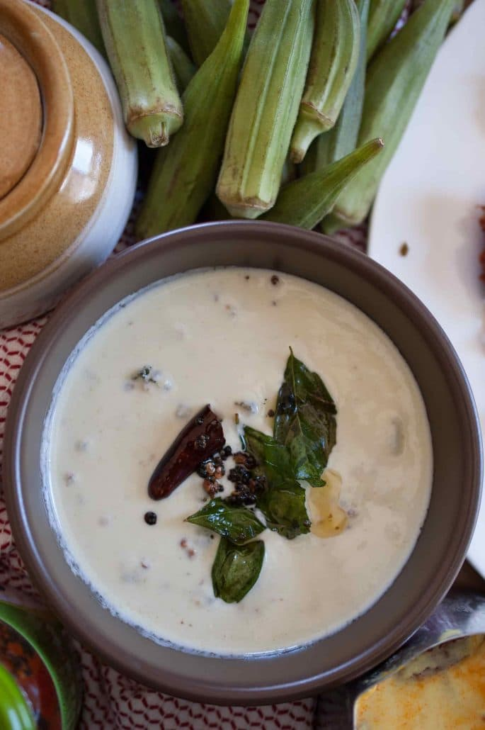 a white curry made with coconut, curd and fried okra