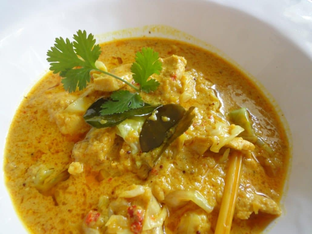A creamy yellow curry with chicken, lemongrass, and candlenuts