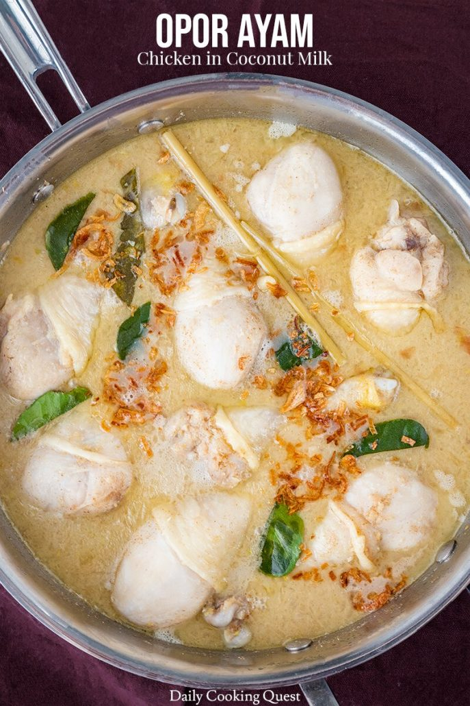 A white soupy curry with whole chicken legs, called opor ayam