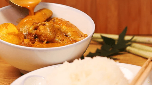 A bright yellow Singapore curry with a whole chicken worth of meat