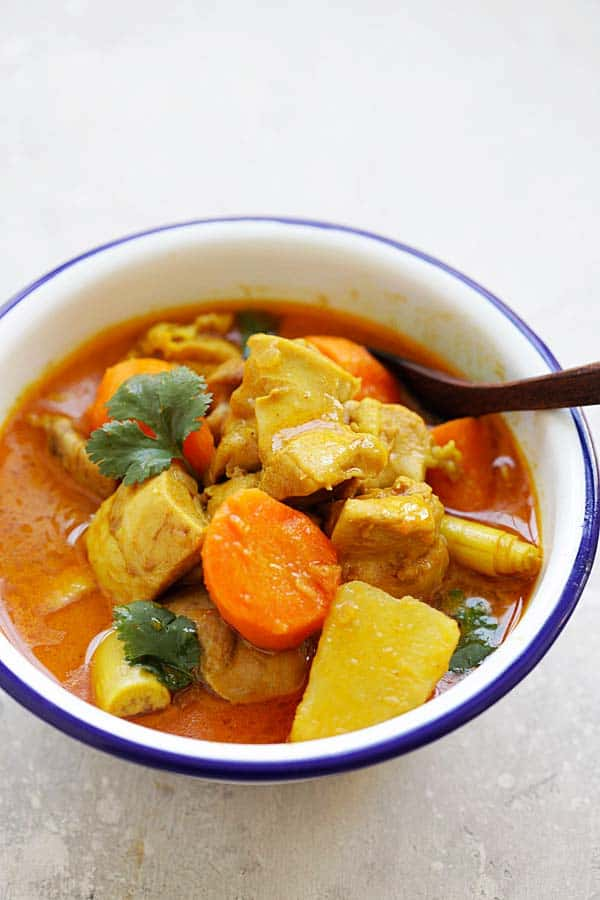 A soupy Vietnamese red curry with potatoes, carrot, onion, coriander, lemongrass, and chicken
