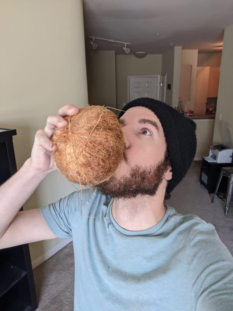 Me drinking coconut juice