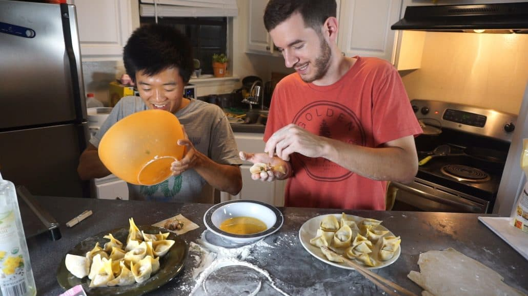 Folding wontons with a bowl of egg wash