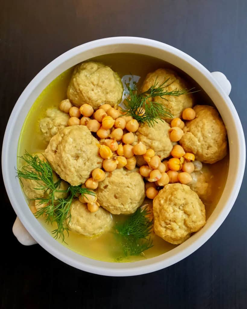 A chicken soup with chickpea dumplings called gondi