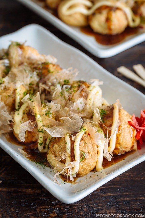 Takoyaki, octopus balls, with mayonnaise and bonito flakes on top