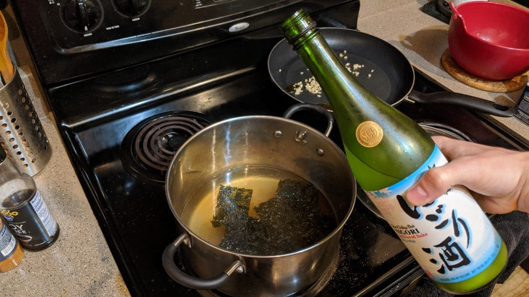 Adding sake to the shio ramen broth.