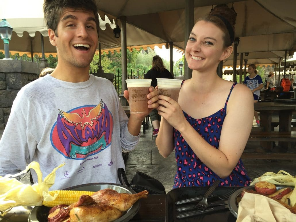 My brother and his girlfriend eating and drinking at The Tree Broomsticks, in the Wizarding World of Harry Potter