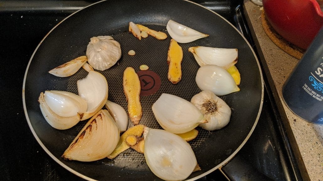 Sliced veggies being caramelized in a skillet
