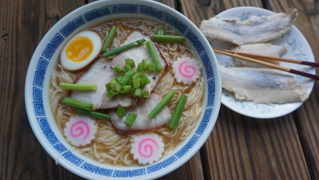 A bowl of Wakayama ramen, with a small plate of pickled mackerel on the side.