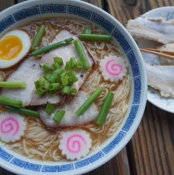 A bowl of Wakayama ramen with a plate of pickled mackerel on the side