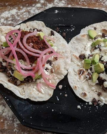 2 finished baleadas on a plate