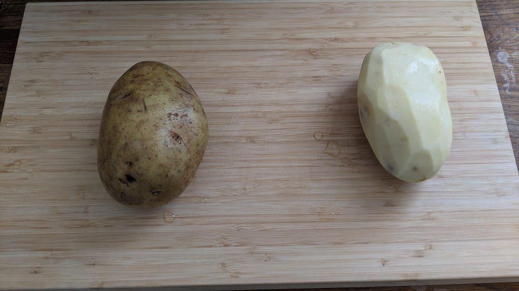 A peeled and unpeeled potato